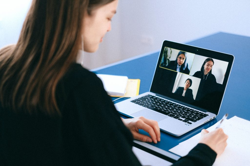 Image of someone in a video call on a laptop